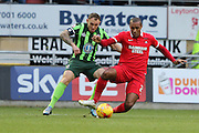 Barry Fuller (Captain) of AFC Wimbledon and Jay Simpson of Leyton Orient during Sky Bet League 2 match between Leyton Orient and AFC Wimbledon at the Matchroom Stadium, London, England on 28 November 2015. Photo by Stuart Butcher.