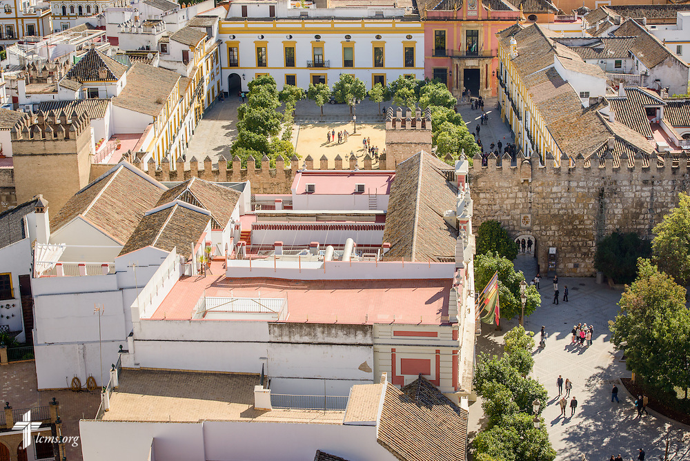 Tourists are framed by surrounding buildings, seen from the Giralda bell tower, on Monday, Nov. 7, 2016, in Seville, Spain.  LCMS Communications/Erik M. Lunsford