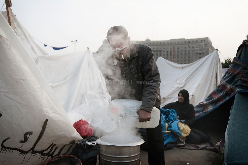 november 30. Egypt 2011. Cairo. Tahrir square. A man cooking in Tahrir Square.