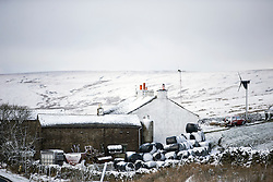 © Licensed to London News Pictures. 16/04/2016. Ribblehead UK. Picture shows a snow covered farm this morning after last night's snow fall in the Yorkshire Dales. Photo credit: Andrew McCaren/LNP