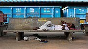 16th August 2014,New Delhi. A boy sleeps on a concrete bench and a dog sleeps underneath it on a railway platform in New Delhi, India on the 16th August 2014<br /> <br /> Sleeping in the outdoors is common in Asia due to a warmer climate and the fact that personal privacy for sleep is not so culturally ingrained as it is in the West. New Delhi (where most of these images were taken) is a harsh city both in climate and environment and for those working long hours, often in hard manual labour, sleep and rest is something fallen into when exhaustion overwhelms, no matter the place or circumstance. Then there are the homeless, in Delhi figures for them from Government and NGO sources vary wildly from 25,000 to more than 10 times that. Others public sleepers may simply be travellers having a siesta along the way.<br />  <br /> <br /> PHOTOGRAPH BY AND COPYRIGHT OF SIMON DE TREY-WHITE, photographer in Delhi<br /> <br /> + 91 98103 99809<br /> email: simon@simondetreywhite.com