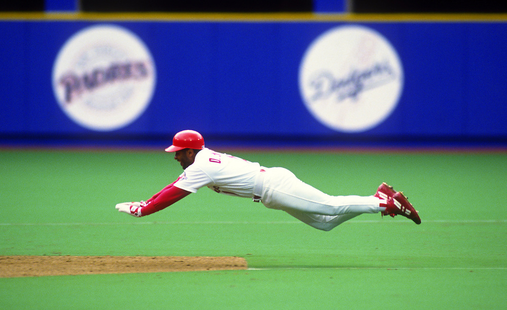 ST. LOUIS - 1994:  Ozzie Smith of the St. Louis Cardinals flies through the air during a head first dive while attempting to steal second base during an MLB game at Busch Stadium in St. Louis, Missouri.  Smith played for the Cardinals from 1982-1996.  (Photo by Ron Vesely)