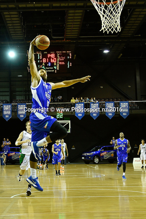 Dion Prewster of the Saints slam dunks the ball during the NBL Wellington Saints vs Super City Rangers basketball match at the TSB Arena in Wellington on Thursday the 10th of March 2016. Photo by Marty Melville / www.Photosport.nz