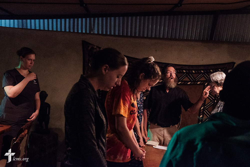 The Rev. Daniel Mulholland, team chaplain and pastor of Shepherd of the Valley Lutheran Church, Fort Bridger, Wyo., leads the group in prayer at the close of the fifth day of the LCMS Mercy Medical Team on Friday, May 11, 2018, at a hotel in Koidu, Sierra Leone, West Africa. LCMS Communications/Erik M. Lunsford