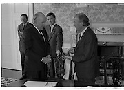 Charles Haughey Receives Seal Of Office.   (T3)..1989..12.07.1989..07.12.1989..12th July 1989..After winning the General Election and having been elected Taoiseach by a majority in Dail Eireann, Charles Haughey went to Aras an Uachtarain to accept the seal of office. The seal of office was granted by President Patrick Hillery...Image shows President Patrick Hillery presenting the seal of office An Taoiseach, Charles Haughey,at the office in Aras an Uachtarain.