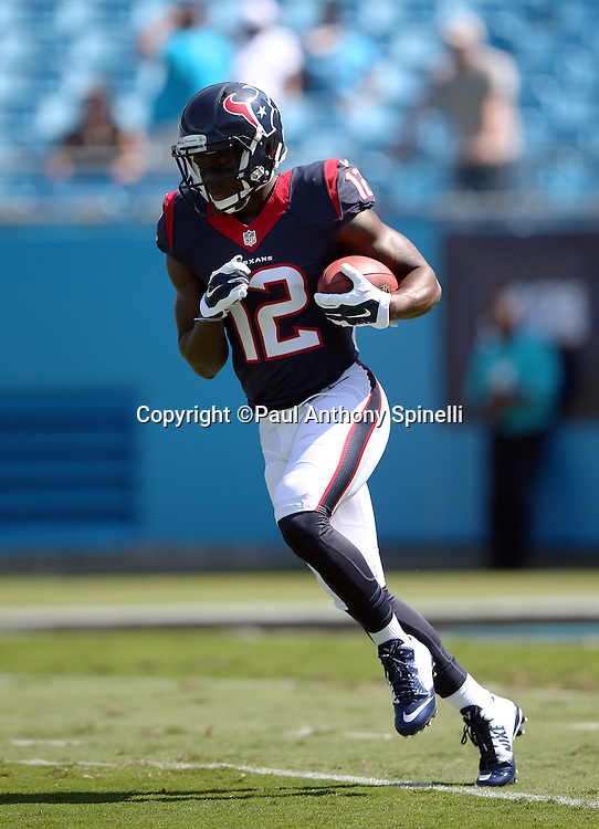Houston Texans wide receiver Keith Mumphery (12) runs with the ball while warming up before the 2015 NFL week 2 regular season football game against the Carolina Panthers on Sunday, Sept. 20, 2015 in Charlotte, N.C. The Panthers won the game 24-17. (©Paul Anthony Spinelli)