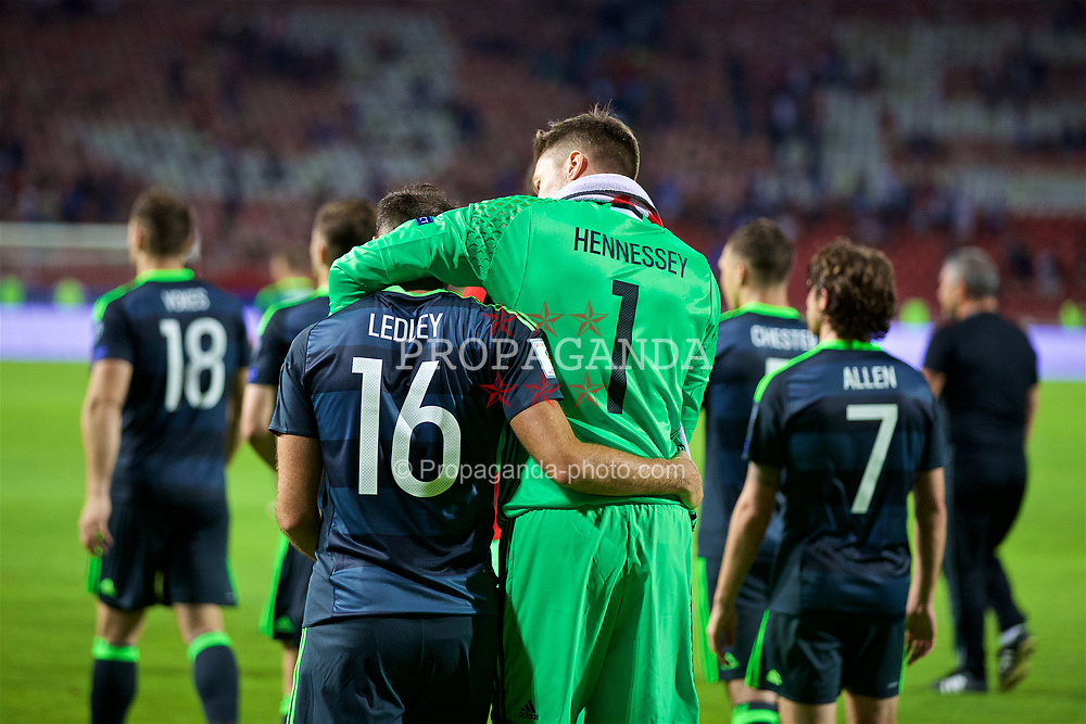 BELGRADE, SERBIA - Sunday, June 11, 2017: Wales' Joe Ledley and goalkeeper Wayne Hennessey after the 1-1 draw with Serbia during the 2018 FIFA World Cup Qualifying Group D match between Wales and Serbia at the Red Star Stadium. (Pic by David Rawcliffe/Propaganda)