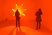 "© Licensed to London News Pictures. 29/01/2013. London, UK People look at Ann Veronica Janssens' work, ""Rose (2007). Press preview of ""Light Show"" at the Hayward Gallery at the Southbank Centre in London today 29th January 2013. The exhibition runs 30th Jan-28th Apr 2013. Photo credit : Stephen Simpson/LNP"