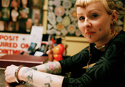 Picture by Mark Larner. Picture shows Anne at New Wave Tattoo studio..London College of Printing BA (Hons) degree project on tattooing 1999-2000