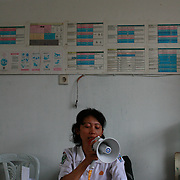 A nurse calling out patients in Wamena hospital