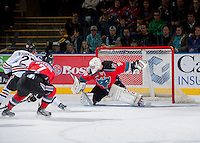 KELOWNA, CANADA - OCTOBER 5:  Jordon Cooke #30 of the Kelowna Rockets makes a save against the Portland Winterhawks  at the Kelowna Rockets on October 5, 2013 at Prospera Place in Kelowna, British Columbia, Canada (Photo by Marissa Baecker/Shoot the Breeze) *** Local Caption ***