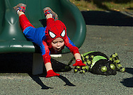 Middletown, New York  - A young boy wearing a costume uses the slide in the playground during the Halloween Fall Festival at the Middletown YMCA's Center for Youth Programs on Oct. 25, 2014.