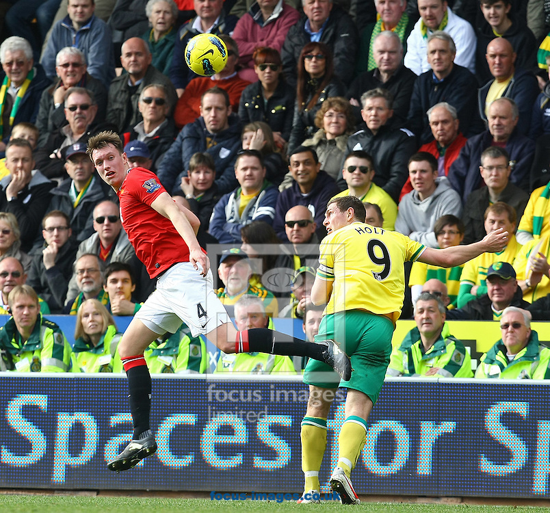 Picture by Paul Chesterton/Focus Images Ltd.  07904 640267.26/02/12.Phil Jones of Man Utd and Grant Holt of Norwich in action during the Barclays Premier League match at Carrow Road Stadium, Norwich.