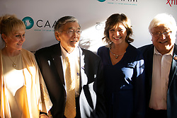 """Norman Mineta, second from left, poses for a photograph with his wife Danealia, left, and former U.S. Rep. Mike Honda, right, and Honda's friend Florence Koga, at the CAAM Film Festival's world premiere of """"An American Story: Norman Mineta and His Legacy"""" at the Castro Theatre, Thursday, May 10, 2018 in San Francisco, Calif. (D. Ross Cameron/SF Chronicle)"""