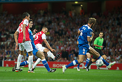 LONDON, ENGLAND - WEDNESDAY, SEPTEMBER 28, 2011: Arsenal's Alex Oxlade-Chamberlain scores the opening goal against Olympiacos during the UEFA Champions League Group F match at the Emirates Stadium. (Photo by Chris Brunskill/Propaganda)