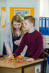 Pictured: Carla Hay, Youth music initiative project assistant helps Mark Lynch get musical notes out of a banana<br /> <br /> Culture Secretary Fiona Hyslop MSP unveiled cash awards for Youth Music Initiative schemes which will help young people learn about and enjoy music. Ms Hyslop made the announcement when she joined schoolchildren at Longstone Primary School, Edinburgh today.<br /> <br /> <br /> Ger Harley | EEm 8 March 2018