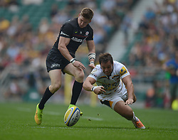 Saracens Winger Chris Ashton and Wasps Full Back Rob Miller chases down the ball.- Photo mandatory by-line: Alex James/JMP - 07966 386802 - 06/09/2014 - SPORT - RUGBY UNION - London, England - Twickenham Stadium - Saracens v Wasps - Aviva Premiership London Double Header.