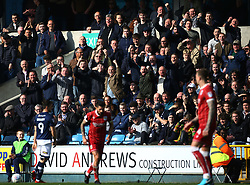 Millwall fans gesture toward Bristol City players, during their Sky Bet Championship football match at The Den, in south London