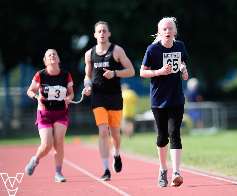 Metro Blind Sport's 2017 Athletics Open held at Mile End Stadium.  5000m.  From left, Lynn Cox with guide runner and Emma Quigley<br /> <br /> Picture: Chris Vaughan Photography for Metro Blind Sport<br /> Date: June 17, 2017