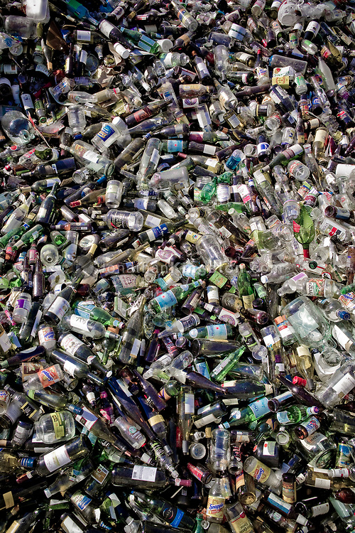 A large group of glass bottles sit ready for recycling in Bend, Oregon.