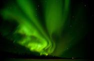 The northern lights blaze over the Kuskokwim River near McGrath during the 2011 Iditarod.