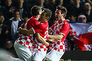 Anas Sharbini of Croatia (left) celebrates scoring the opening goal against Argentina during the International Friendly match at the Boleyn Ground, London<br /> Picture by David Horn/Focus Images Ltd +44 7545 970036<br /> 12/11/2014
