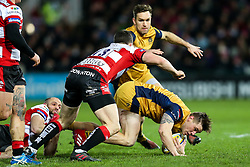 Jason Woodward of Bristol Rugby is tackled by Charlie Sharples and Matt Scott of Gloucester Rugby - Rogan Thomson/JMP - 03/12/2016 - RUGBY UNION - Kingsholm Stadium - Gloucester, England - Gloucester Rugby v Bristol Rugby - Aviva Premiership.