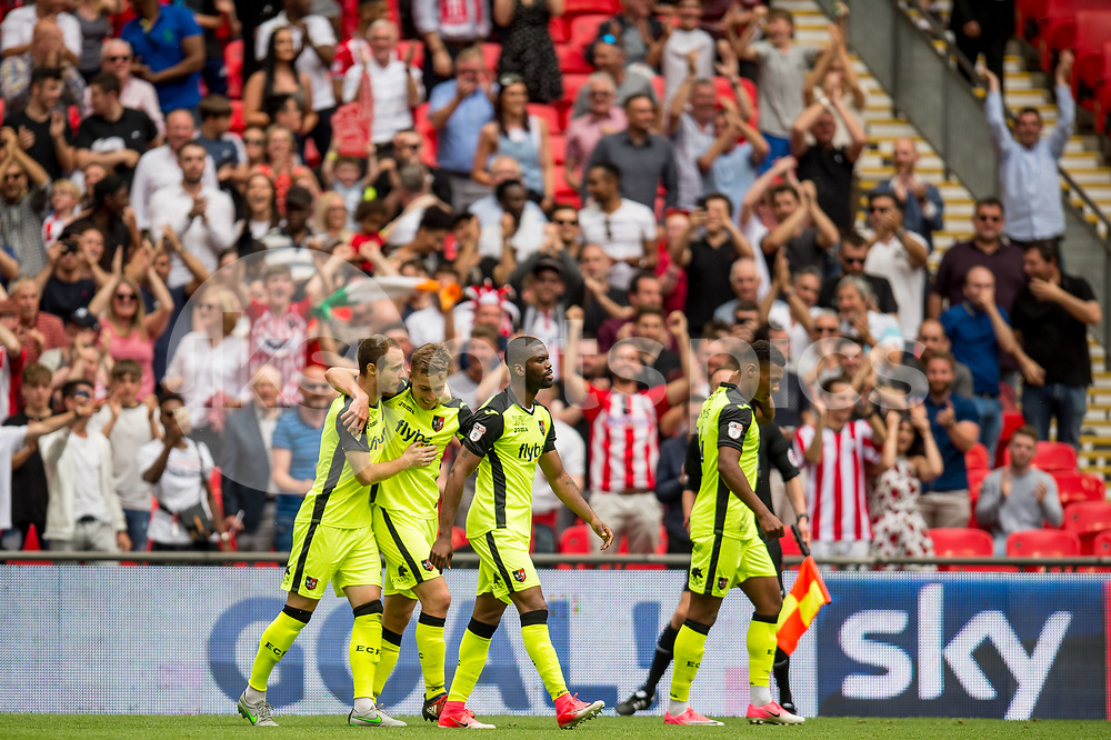 David Wheeler of Exeter City celebrates with team mates after he equalises during the EFL Sky Bet League 2 Play-Off Final match between Blackpool and Exeter City at Wembley Stadium, London, England on 28 May 2017. Photo by Matthew Buchan.