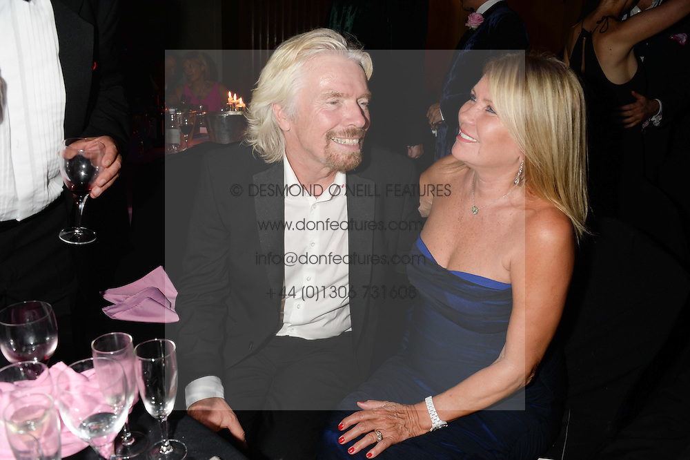 British fine jewellery brand Boodles welcomed guests for the 2013 Boodles Boxing Ball in aid of Starlight Children's Foundation held at the Grosvenor House Hotel, Park Lane, London on 21st September 2013.<br /> Picture Shows:-SIR RICHARD BRANSON and LADY BRANSON.<br /> <br /> Press release - https://www.dropbox.com/s/a3pygc5img14bxk/BBB_2013_press_release.pdf<br /> <br /> For Quotes  on the event call James Amos on 07747 615 003 or email jamesamos@boodles.com. For all other press enquiries please contact luciaroberts@boodles.com (0788 038 3003)