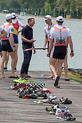 Plovdiv, Bulgaria, 12.05.19,  FISA, Rowing World Cup 1, M4-, AUT, winners of Bronze Medal, b)WALK Florian (2)KOHLMAYR Maximilian (3)QUERFELD Rudolph (s) HOHENSASSER Gabriel, members of the crew carry boat, being congratulated by National Coach, Carsten HASSING, Finals Day, © Karon PHILLIPS/Intersport Images,