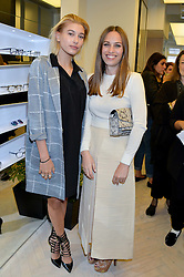 Left to right, HAILEY BALDWIN and ANNA LAUB founder of Prism at the Prism Boutique Summer Party held at Prism, 54 Chiltern Street, London on 14th May 2014.