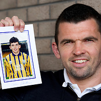 Callum Davidson pictured back at McDiarmid Park after re-signing for St Johnstone...Callum started his career with St Johnstone in 1994 before moving to Blackburn Rovers in 1998 for £1.75m....26.05.11  He is pictured with a photograph of himself when he first signed for St Johnstone in 1994<br /> see story by Gordon Bannerman Tel: 07729 865788<br /> Picture by Graeme Hart.<br /> Copyright Perthshire Picture Agency<br /> Tel: 01738 623350  Mobile: 07990 594431