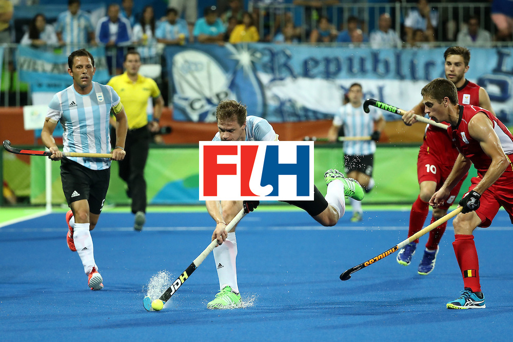 RIO DE JANEIRO, BRAZIL - AUGUST 18:  Lucas Rossi #27 of Argentina  in action during the Men's Hockey Gold Medal match between Belgium and Argentina on Day 13 of the Rio 2016 Olympic Games at Olympic Hockey Centre on August 18, 2016 in Rio de Janeiro, Brazil.  (Photo by Sean M. Haffey/Getty Images)