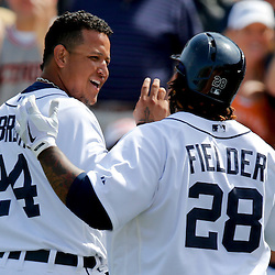 Feb 27, 2013; Lakeland, FL, USA; Detroit Tigers first baseman Prince Fielder (28) celebrates after hitting a two run homerun scoring third baseman Miguel Cabrera (24) during the bottom of the first inning of a spring training game against the Atlanta Braves at Joker Marchant Stadium. Mandatory Credit: Derick E. Hingle-USA TODAY Sports