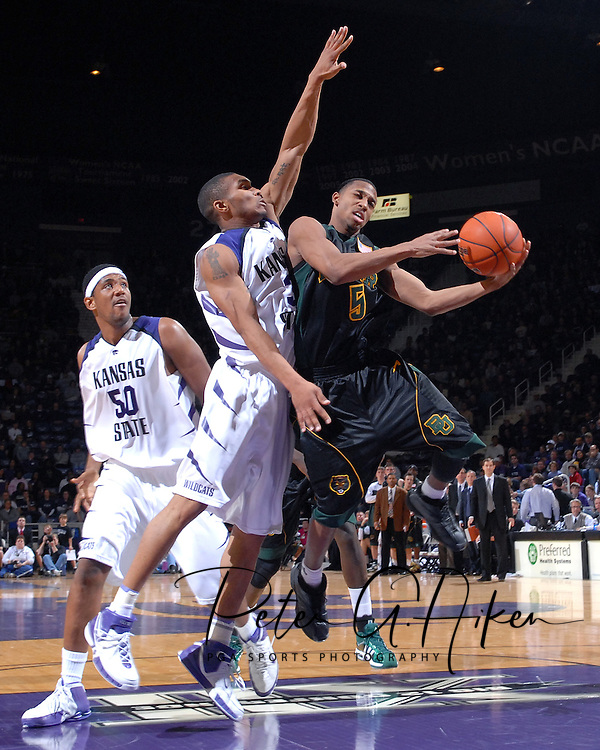 Baylor guard Henry Dugat (5) drives to the basket under pressure from Kansas State's Lance Harris (3) and Luis Colon (50), during the first half at Bramlage Coliseum in Manhattan, Kansas, January 17, 2007.  K-State beat Baylor 69-60