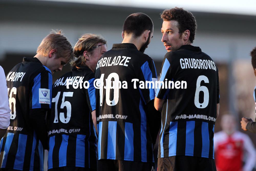 21.4.2013, Kymenlaakson Sähkö Areena, Myllykoski, Kouvola..Veikkausliiga 2013..Myllykosken Pallo-47 - FC Inter Turku..Tamas Gruborovics Interin muurissa.