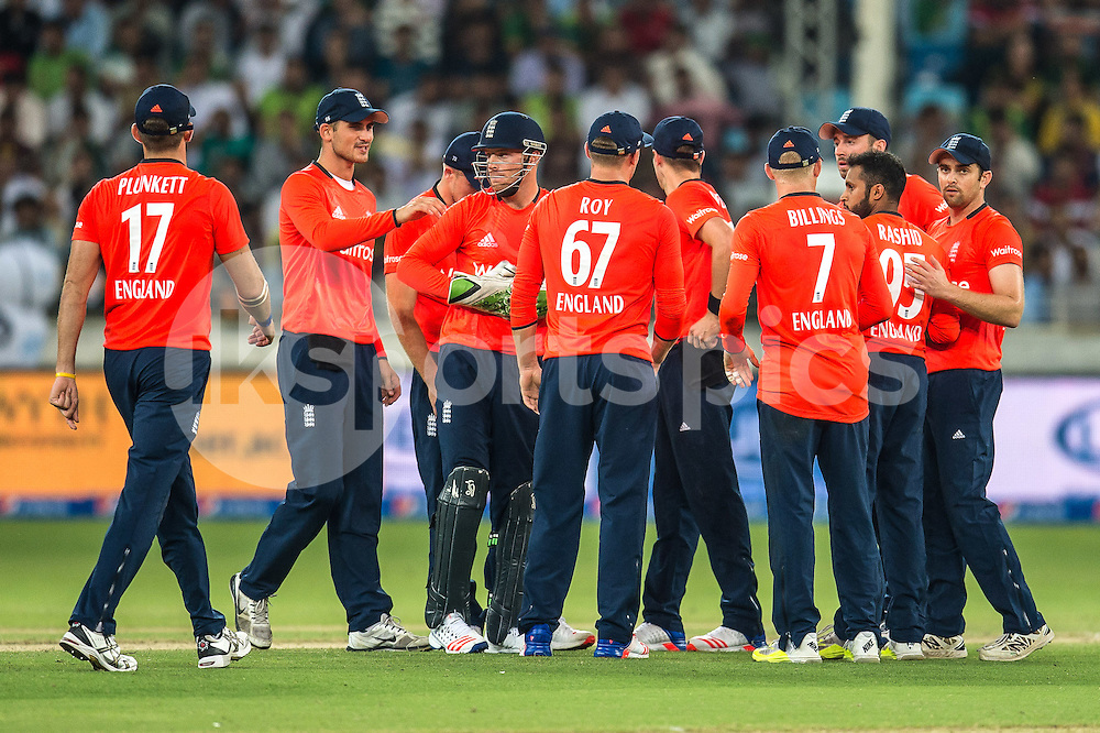 England celebrate the wicket of Rafatullah Mohmand of Pakistan during the 2nd International T20 Series match between Pakistan and England at Dubai International Cricket Stadium, Dubai, UAE on 27 November 2015. Photo by Grant Winter.