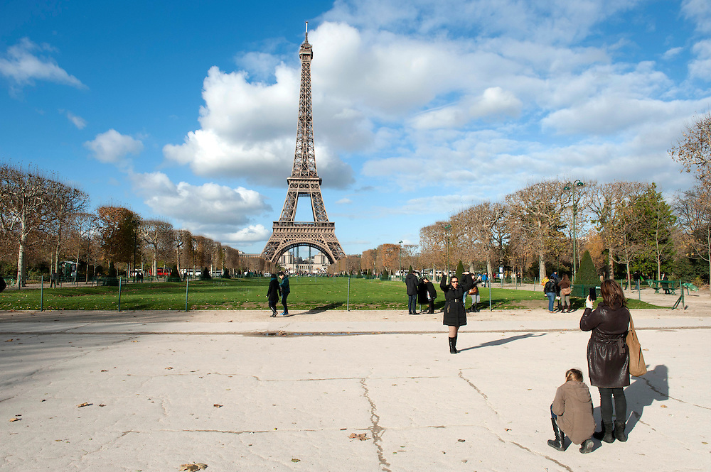 Tourists at the Champ de Mars and the Eiffel Tower, Paris, France