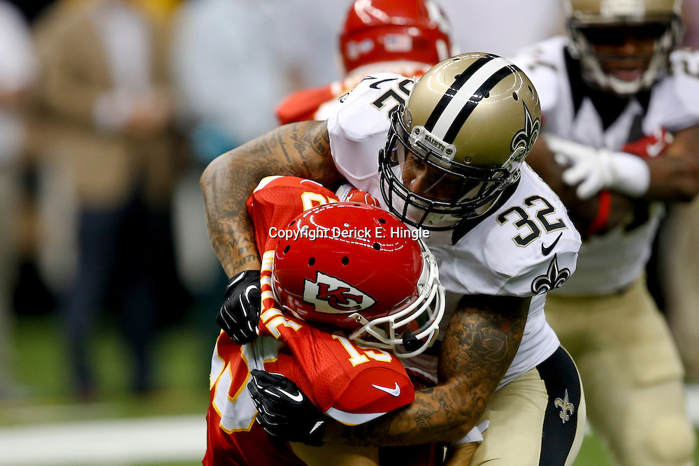 Aug 9, 2013; New Orleans, LA, USA; New Orleans Saints strong safety Kenny Vaccaro (32) tackles Kansas City Chiefs wide receiver Devon Wylie (19) during a preseason game at the Mercedes-Benz Superdome. The Saints defeated the Chiefs 17-13. Mandatory Credit: Derick E. Hingle-USA TODAY Sports