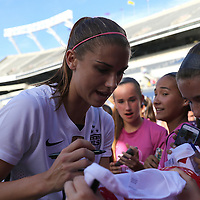 ORLANDO, FL - OCTOBER 25: Alex Morgan #13 of USWNT signs autographs for fans after a women's international friendly soccer match between Brazil and the United States at the Orlando Citrus Bowl on October 25, 2015 in Orlando, Florida. (Photo by Alex Menendez/Getty Images) *** Local Caption *** Alex Morgan