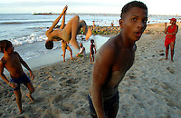 Boys practice flips on the beach in Riohacha, on Colombia's Caribbean coast, on Sunday, December 11, 2005. (Photo/Scott Dalton)