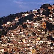 The favela Vila Canoa and favela Vila Pedra Bonita on the hlllside overlooking Leblon and Ipanema beaches, Rio de Janeiro,  Brazil. 12th July 2010. Photo Tim Clayton..