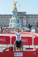 IPC World Cup - Men's T51-T52 event winner Santiago Sanz of Spain on the podium at the Virgin Money London Marathon 2014 at the finish line on Sunday 13 April 2014<br />