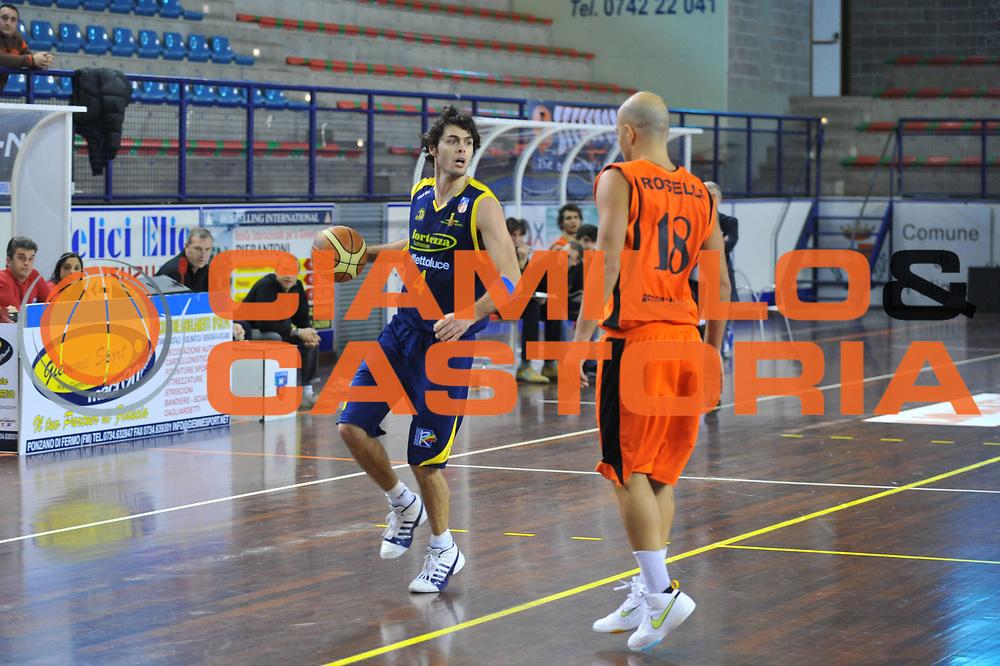DESCRIZIONE : Foligno LNP Lega Nazionale Pallacanestro Serie A Dilettanti Coppa Italia 2009-10 UPEA Liomatic Viola RC La Fortezza Recanati<br /> GIOCATORE :&nbsp;Silvestrucci<br /> SQUADRA : Liomatic Viola RC La Fortezza Recanati<br /> EVENTO : Lega Nazionale Pallacanestro 2009-2010&nbsp;<br /> GARA : Liomatic Viola RC La Fortezza Recanati<br /> DATA : 01/04/2010<br /> CATEGORIA : Palleggio<br /> SPORT : Pallacanestro&nbsp;<br /> AUTORE : Agenzia Ciamillo-Castoria/M.Gregolin<br /> Galleria : Lega Nazionale Pallacanestro 2009-2010&nbsp;<br /> Fotonotizia : Foligno LNP Lega Nazionale Pallacanestro Serie A Dilettanti Coppa Italia 2009-10 UPEA Liomatic Viola RC La Fortezza Recanati<br /> Predefinita