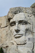 Lincoln carved into rock at Mount Rushmore National Memorial, Keystone, South Dakota, USA. Sculptor Gutzon Borglum designed and oversaw the project 1927–1941, with help from his son, Lincoln Borglum. Mount Rushmore features 60-foot sculptures of the heads of four United States presidents: George Washington (1732–1799), Thomas Jefferson (1743–1826), Theodore Roosevelt (1858–1919), and Abraham Lincoln (1809–1865). South Dakota historian Doane Robinson conceived the idea of carving the likenesses of famous people into the Black Hills in order to promote tourism. Robinson's initial idea of sculpting the Needles was rejected by Gutzon Borglum due to poor granite quality and strong opposition from Native American groups. They settled on Mount Rushmore, and Borglum decided on the four presidents. Each president was originally to be depicted from head to waist, but lack of funding ended construction in late October 1941. Mount Rushmore is a batholith (massive intrusive igneous rock) rising to 5725 feet elevation in the Black Hills.