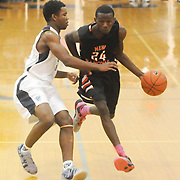 New Hanover's Acchaeus Fields drives around Hoggard's Trae Bryant Friday December 12, 2014 at Hoggard High School in Wilmington, N.C. (Jason A. Frizzelle)