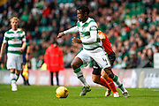 Celtic FC Defender Efe Ambrose taking on Dundee United Midfielder John Rankin during the Ladbrokes Scottish Premiership match between Celtic and Dundee United at Celtic Park, Glasgow, Scotland on 25 October 2015. Photo by Craig McAllister.