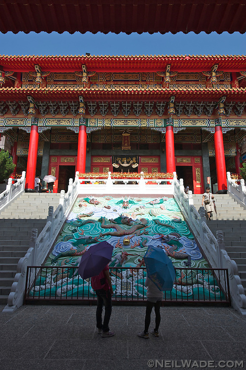 Two visitors admire a relief carving at the Wenwu Temple in Sun Moon Lake, Taiwan.