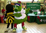 "The Phillie Phanatic, right, and the ""B101 Bee"", a local radio station mascot, dance at the Citizens Bank gift wrapping stand, at the Granite Run Mall, Friday, Dec. 14, 2001, in Media, Pa. Citizens Bank is celebrating it's arrival in Pennsylvania , and thanking it's customers with free gift wrapping service at five Pennsylvania malls. (Photo by William Thomas Cain/photodx.com)"