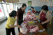 Shopping for the week's worth of food in the family portrait, Li Jinxian and Cui Haiwang buy chicken, lamb, and pork at the Luckybird Meat Store No. E0001 in the market town nearest their small village of Weitaiwu, which is located in the Beijing Province of China. Hungry Planet: What the World Eats (p. 86). The Cui family of Weitaiwu village, Beijing Province, China, is one of the thirty families featured, with a weeks' worth of food, in the book Hungry Planet: What the World Eats.